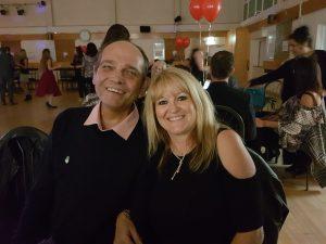 Mick sitting beside wife Deborah